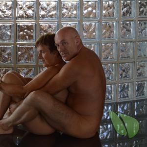 Solo nude couple sitting at home