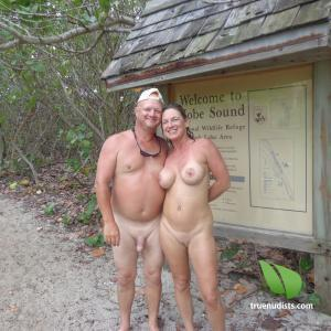 Solo nudist couple out and about