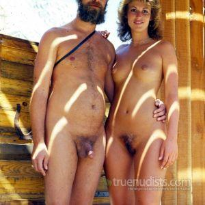 One nudist couple in the woods